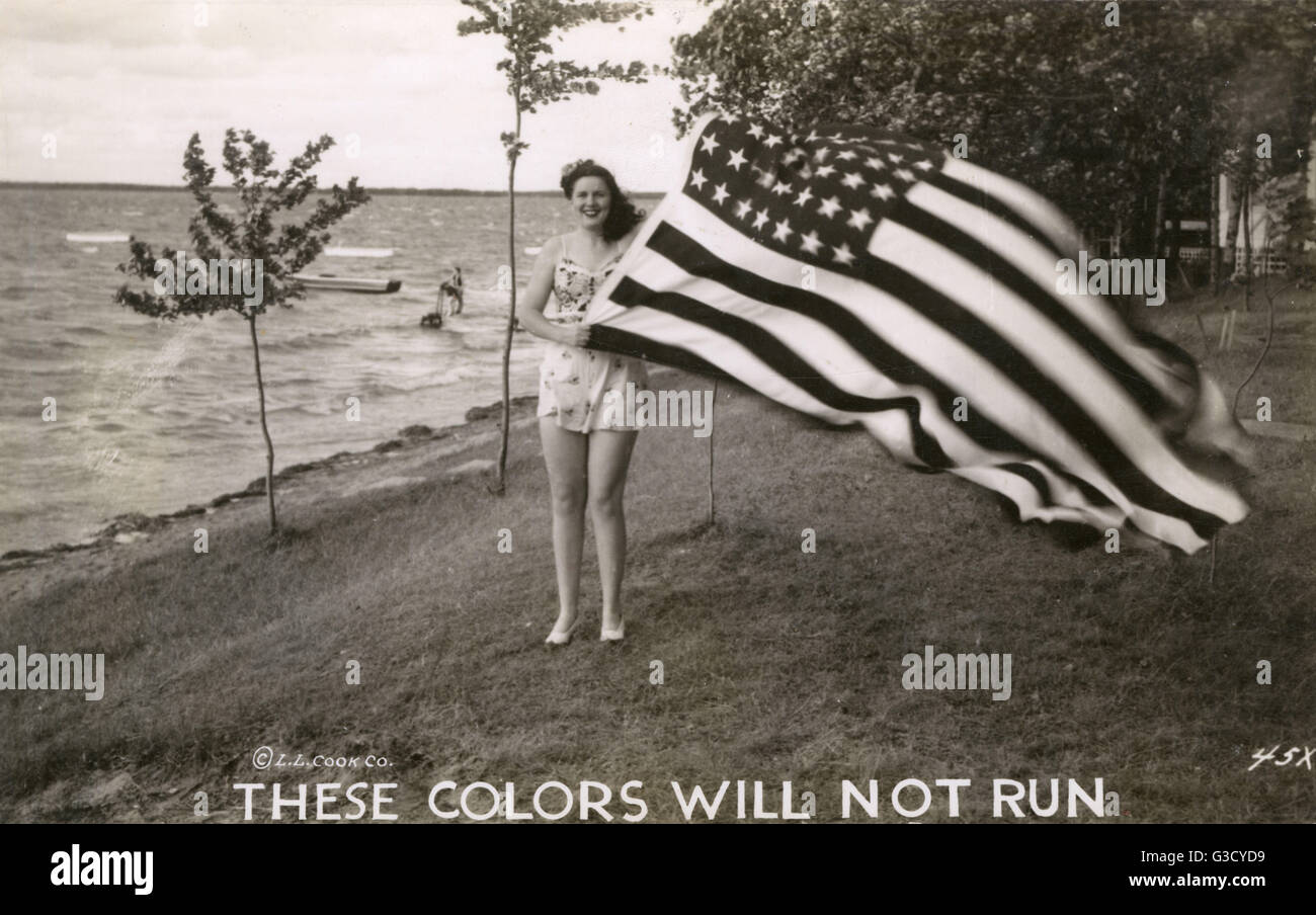 WW2 - American Patriotic Postcard - Woman holding Stars and Stripes Flag, with the caption: 'These Colors will - Stock Image
