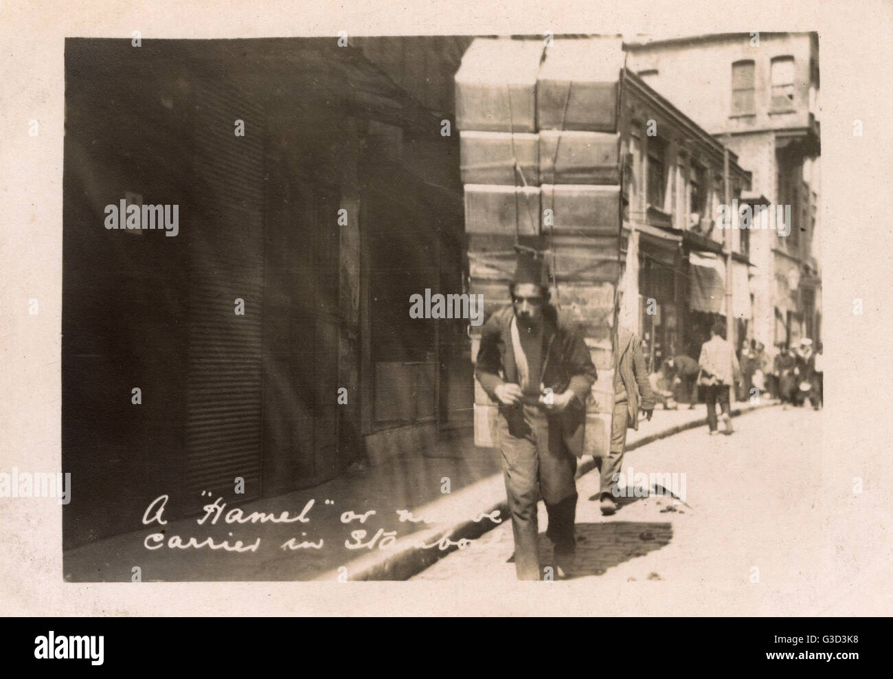 Istanbul, Turkey - Turkish Porter carrying an immense load on his back.     Date: 1923 - Stock Image