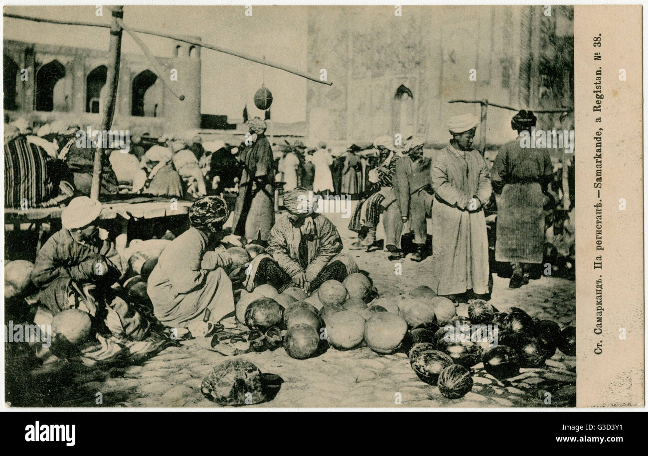 Melon Sellers - The Registan - the heart of the ancient city of Samarkand of the Timurid dynasty, now in Uzbekistan. - Stock Image