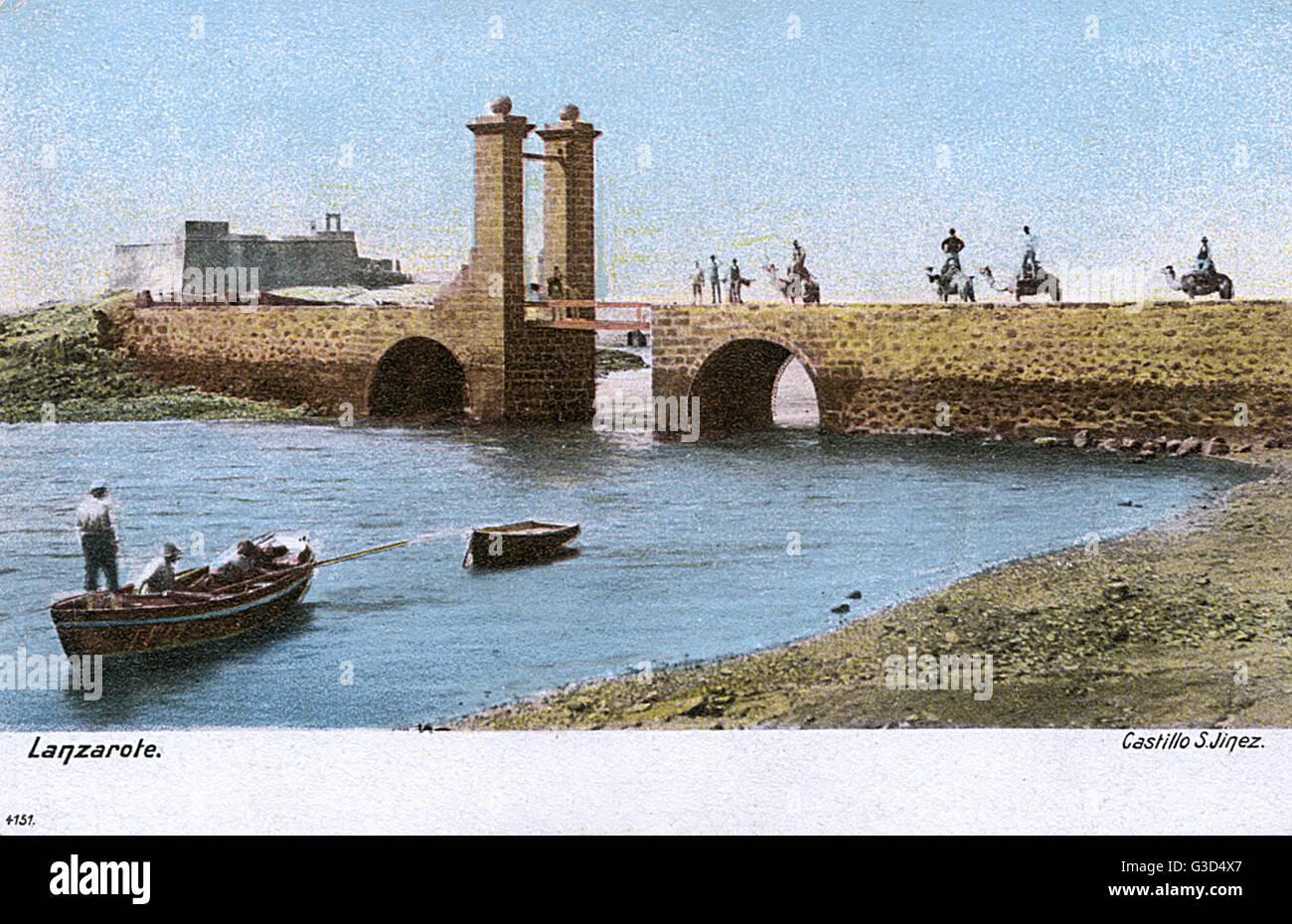 Bridge (Puente de las Bolas) at Arrecife, Lanzarote, Canary Islands, with the San Gabriel Castle on the left.   Stock Photo
