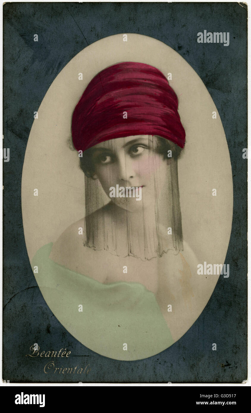 Oriental Beauty - or, to be more precise, a French Model with a painted-on veil and turban.....     Date: late 1920s - Stock Image