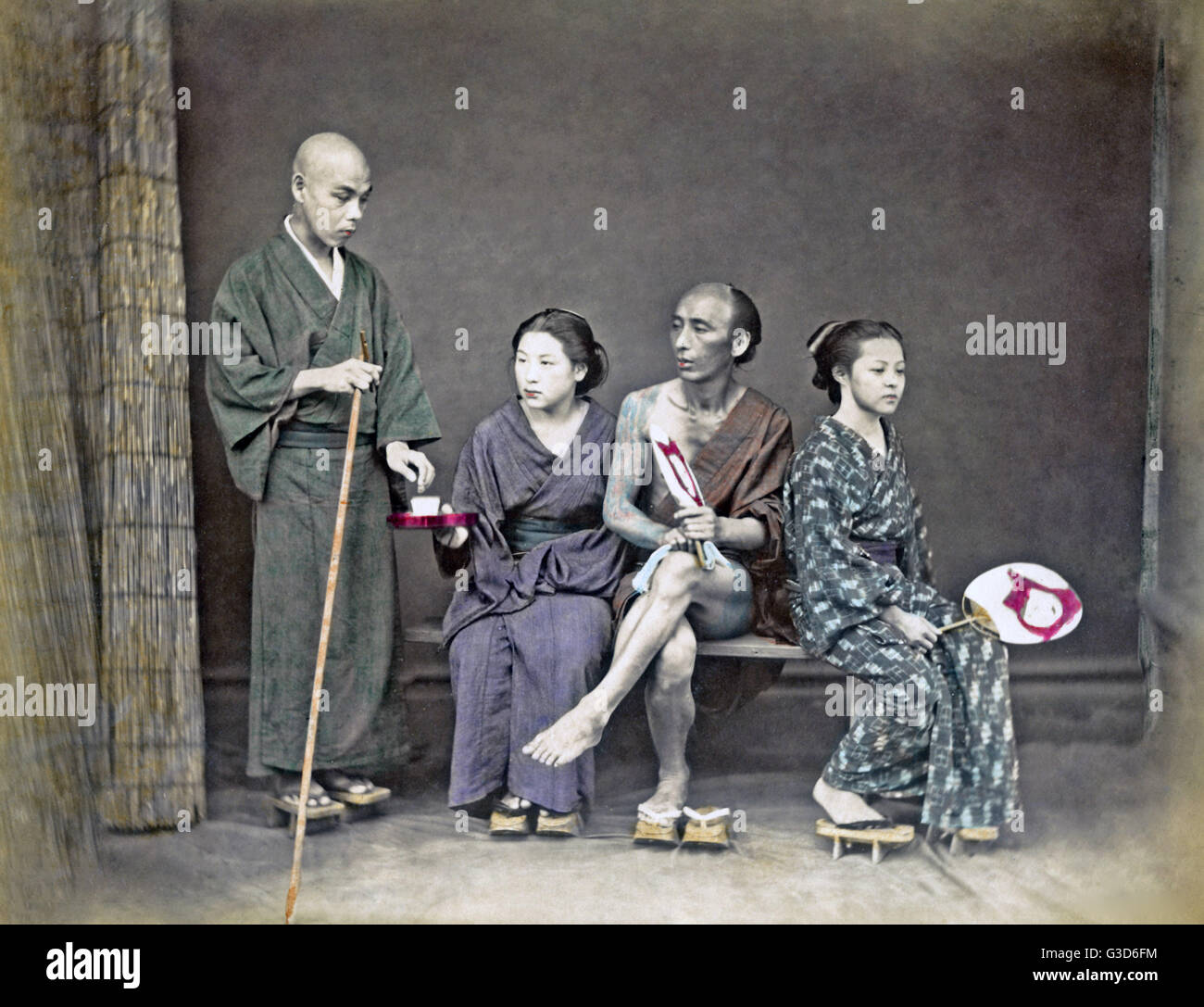 Studio tableau that appears to depict tea being offered to pilgrims, Japan, circa 1880s     Date: circa 1880s - Stock Image