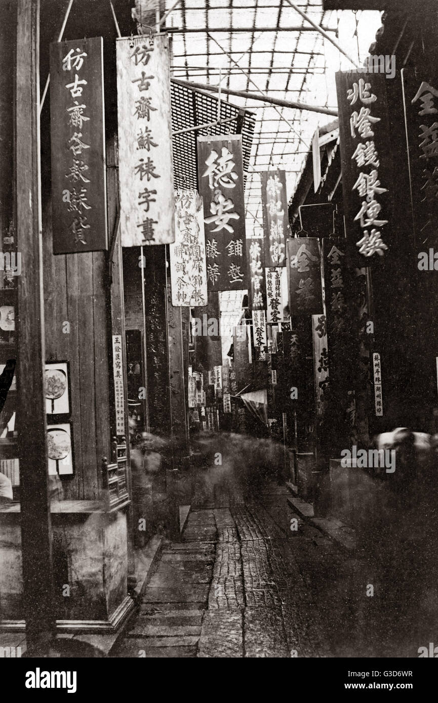 Heavenly Peace Street, Canton, (Guangzhou), China, circa 1880s.     Date: circa 1880s - Stock Image