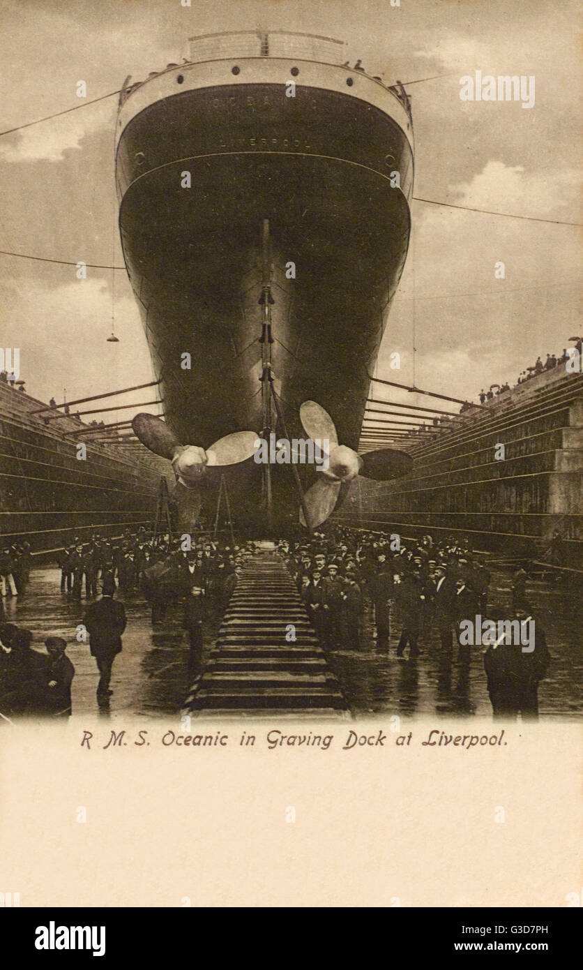 RMS Oceanic in Graving Dock (Dry Dock), Liverpool, shortly before launch in 1899.     Date: circa 1899 - Stock Image