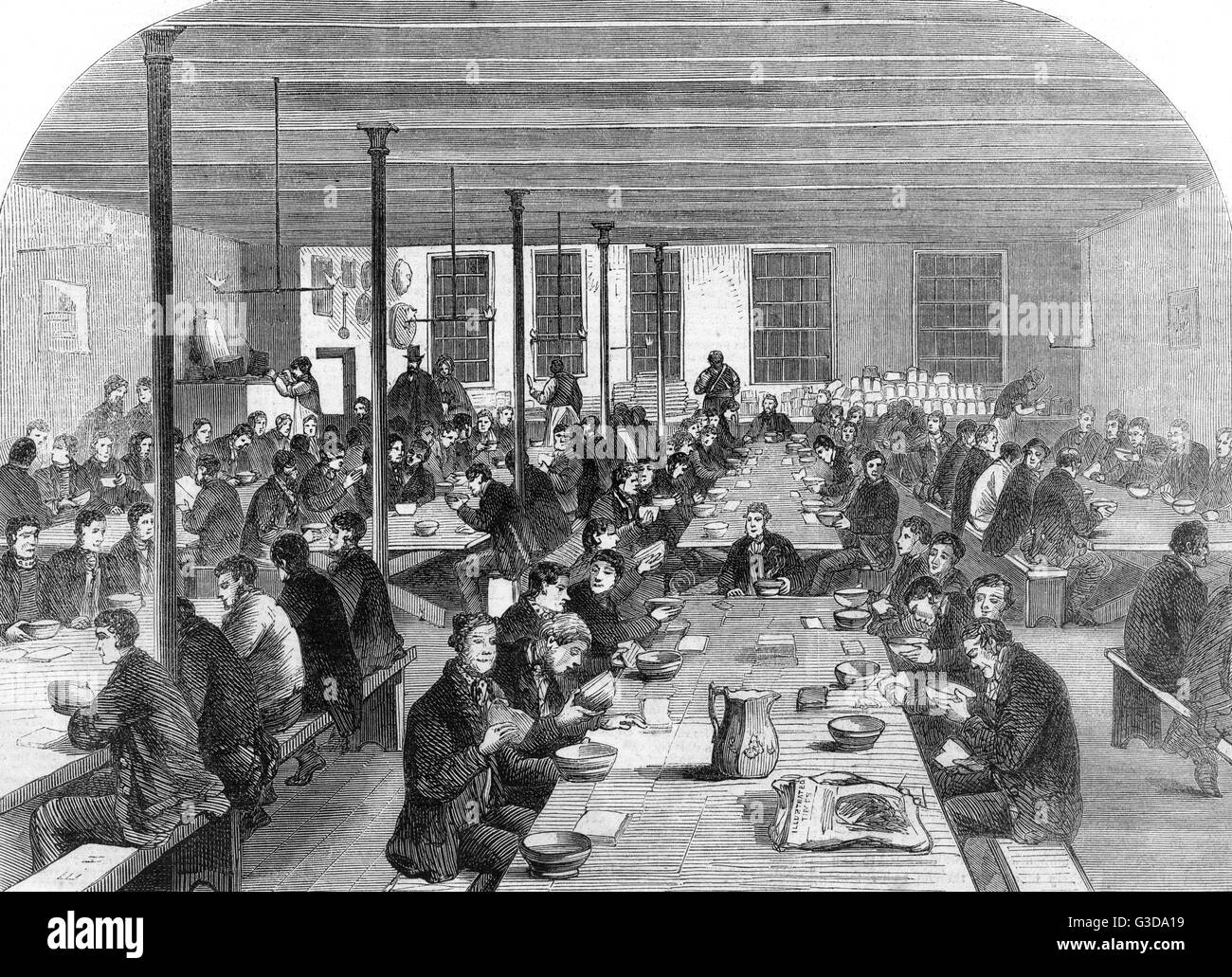 Mens tearoom at the Institute for the unemployed, City Road, Manchester. The kitchen provides soup, bread, hash, - Stock Image
