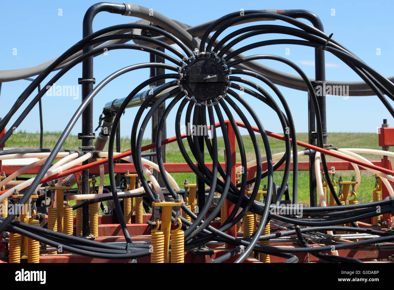A manifold on an air hoe drill, used with an air seeder. Alberta, Canada. Stock Photo