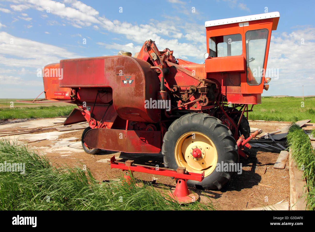 A Massey Ferguson Super 92 combine without a header. In Alberta, Canada. - Stock Image