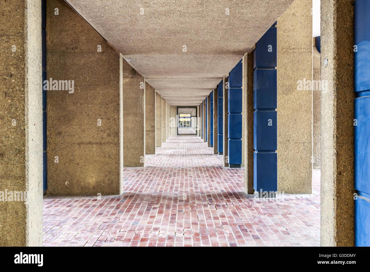 Brutalist architecture, pedestrian hallway in the Barbican Complex, London - Stock Image