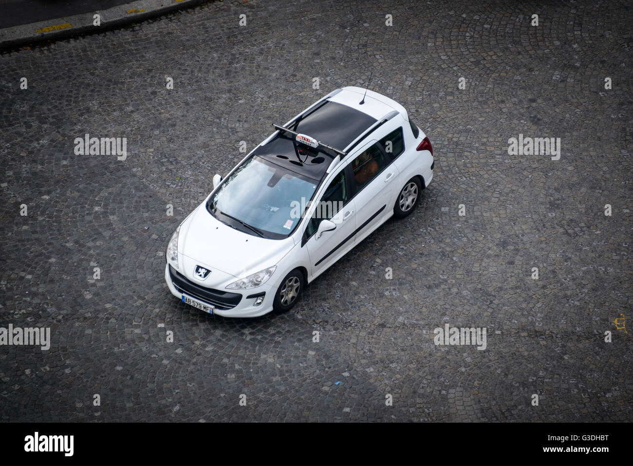 Bird's eye view of a Peugeot 308 SW Parisian taxi - Stock Image