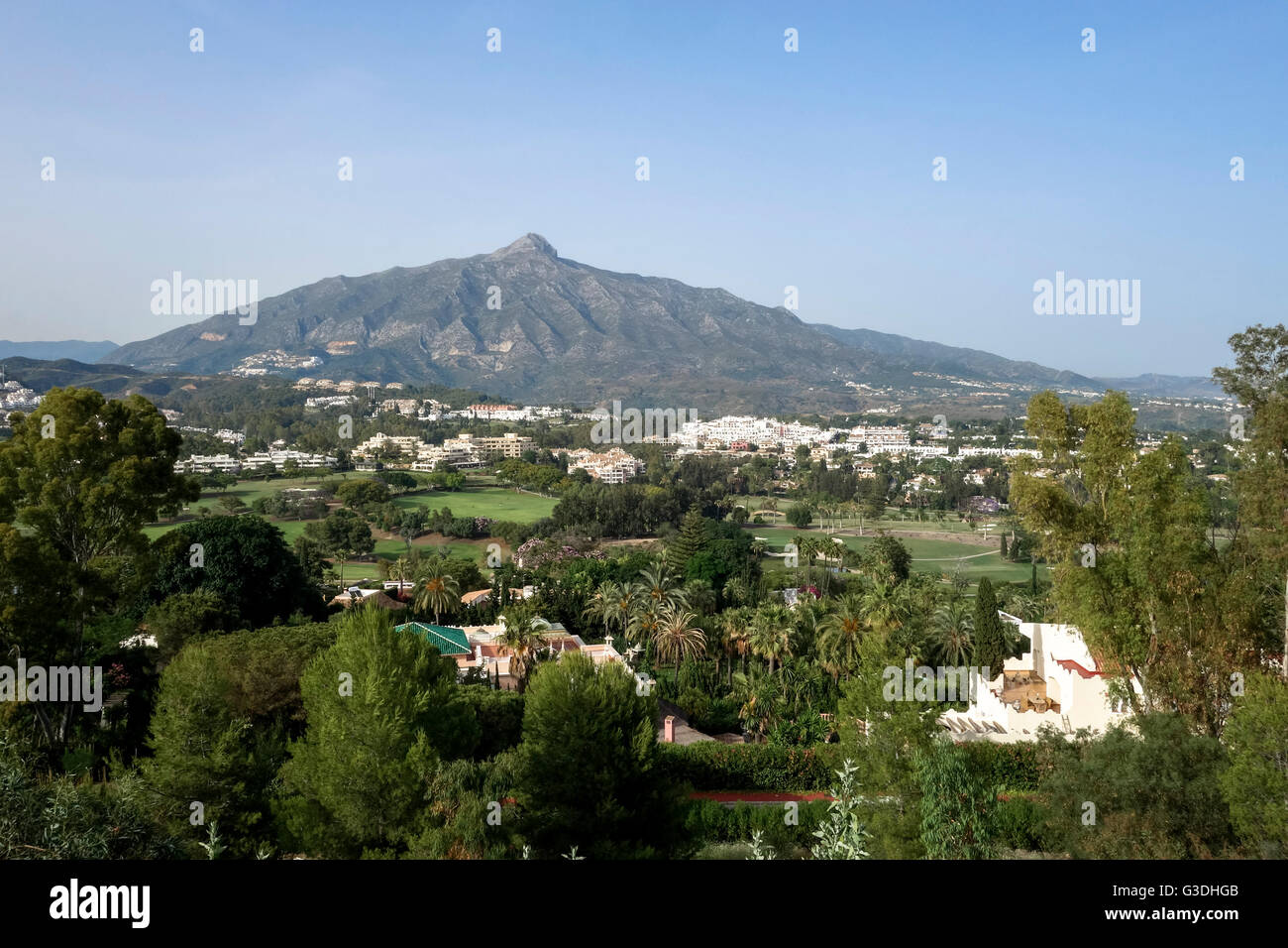 Overlooking golf courses of Marbella, with La Concha mountain in background, Marbella, Andalusia, Spain. Stock Photo