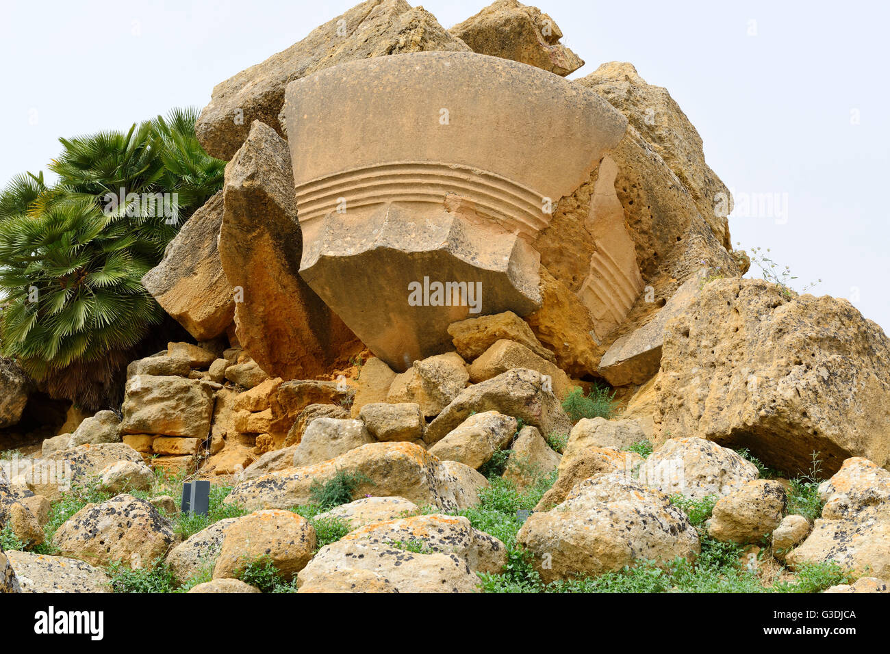 Fallen column capital from Temple of Olympian Zeus in Valley of the Temples (Valle dei Templi), Agrigento, Sicily, - Stock Image