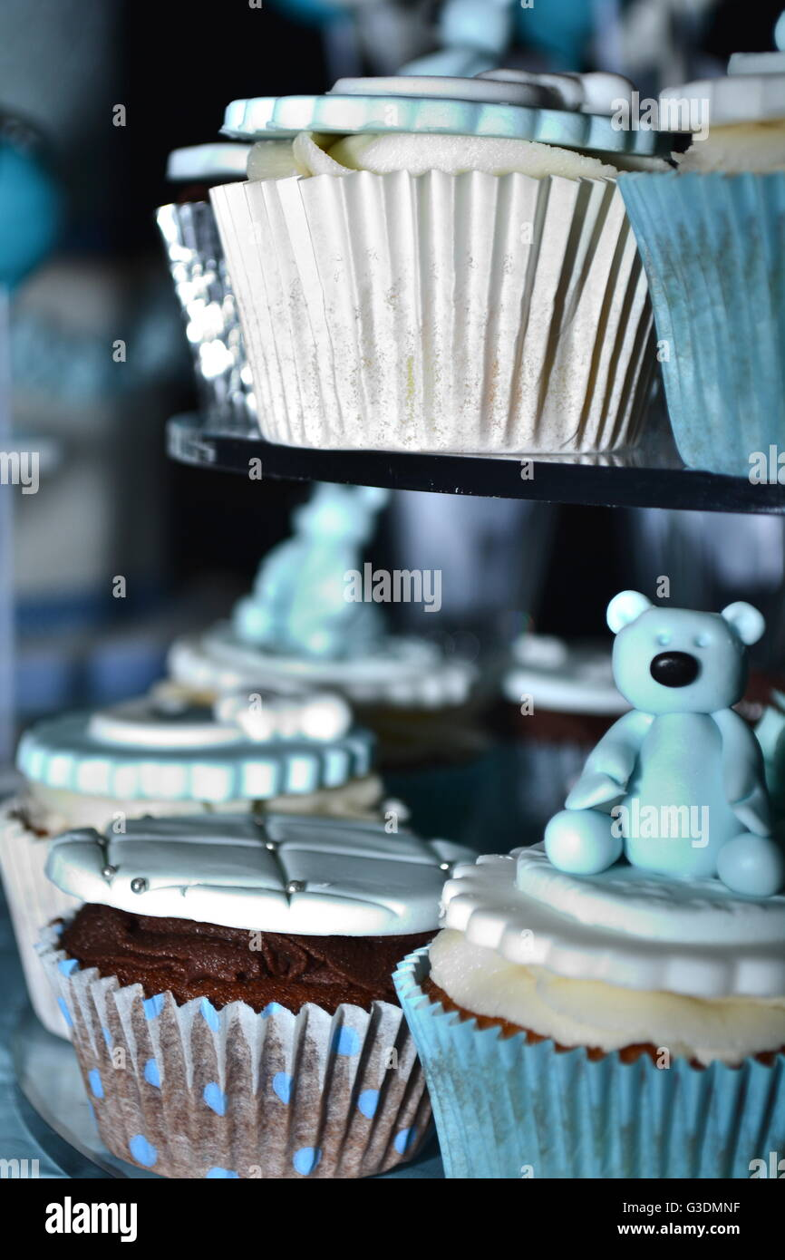 blue cupcakes on cake stand - Stock Image