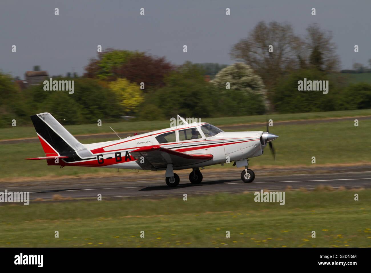 Single propeller aircraft taxiing alon runway after landing at Wolverhampton Halfpenny Green Airport. UK - Stock Image