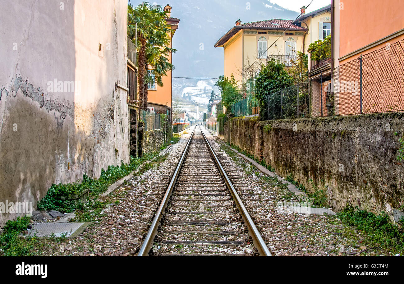 Brescia, Italy - February 16, 2013: the train tracks that pass through the town of Pisogne Lake Iseo - Stock Image
