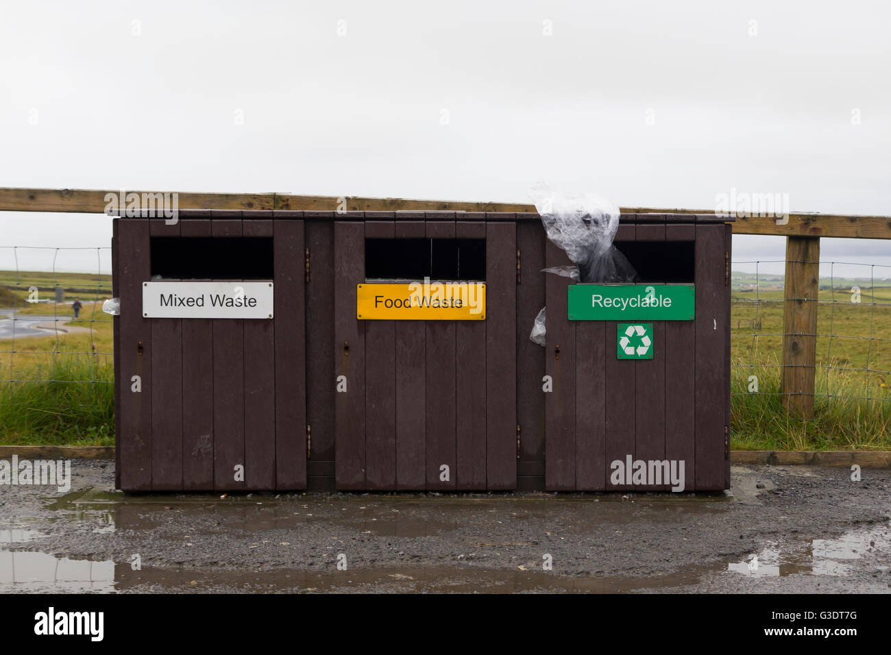 Three rubbish bins for mixed waste, food and recyclable - Stock Image