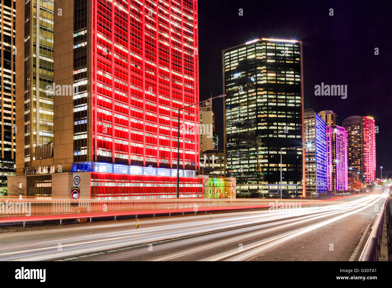 Headlamps of passing cars on a motorway in Sydney, Australia, during annual vivid Sydney light show. Illuminated - Stock Image