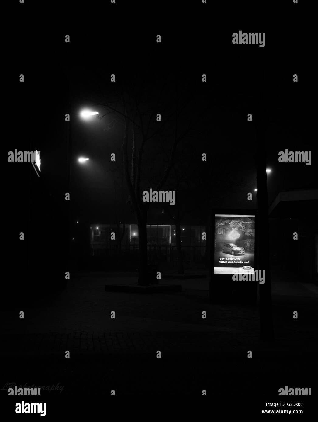 night photography in british town in monochrome - Stock Image