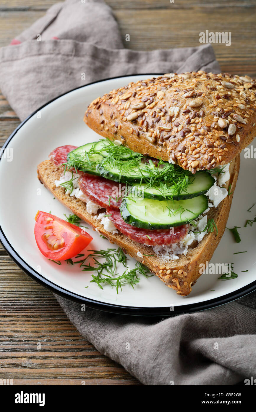 sandwich with cucumber and sausage, food close-up - Stock Image