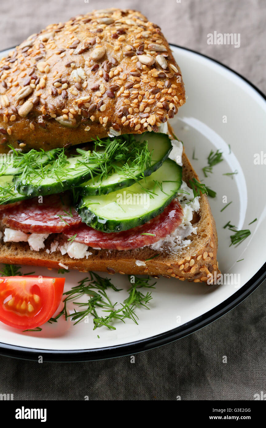 breakfast sandwich with sausage, food close-up - Stock Image
