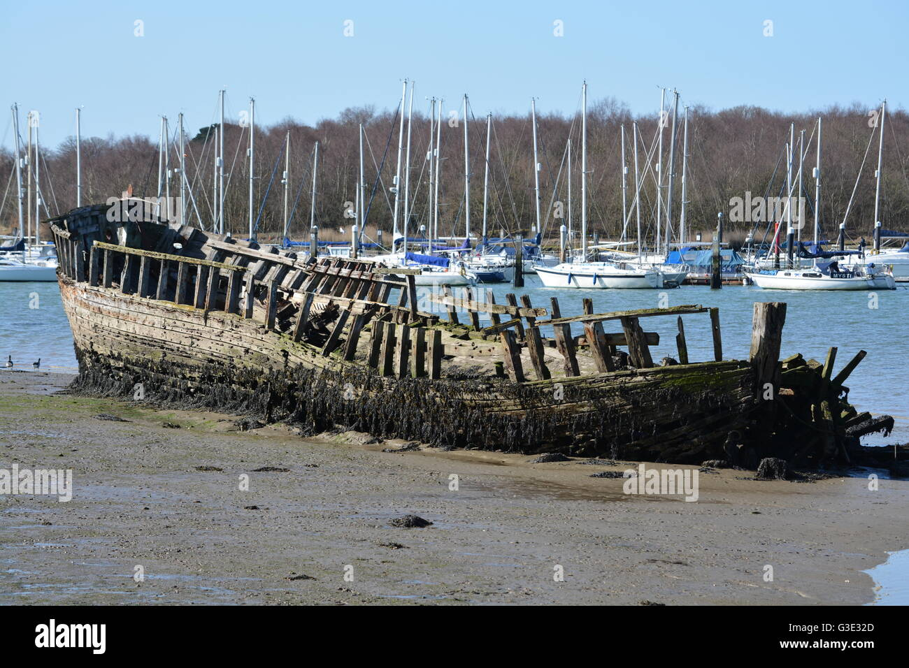 Wreck on the mudflat of the River Hamble, Southampton - Stock Image