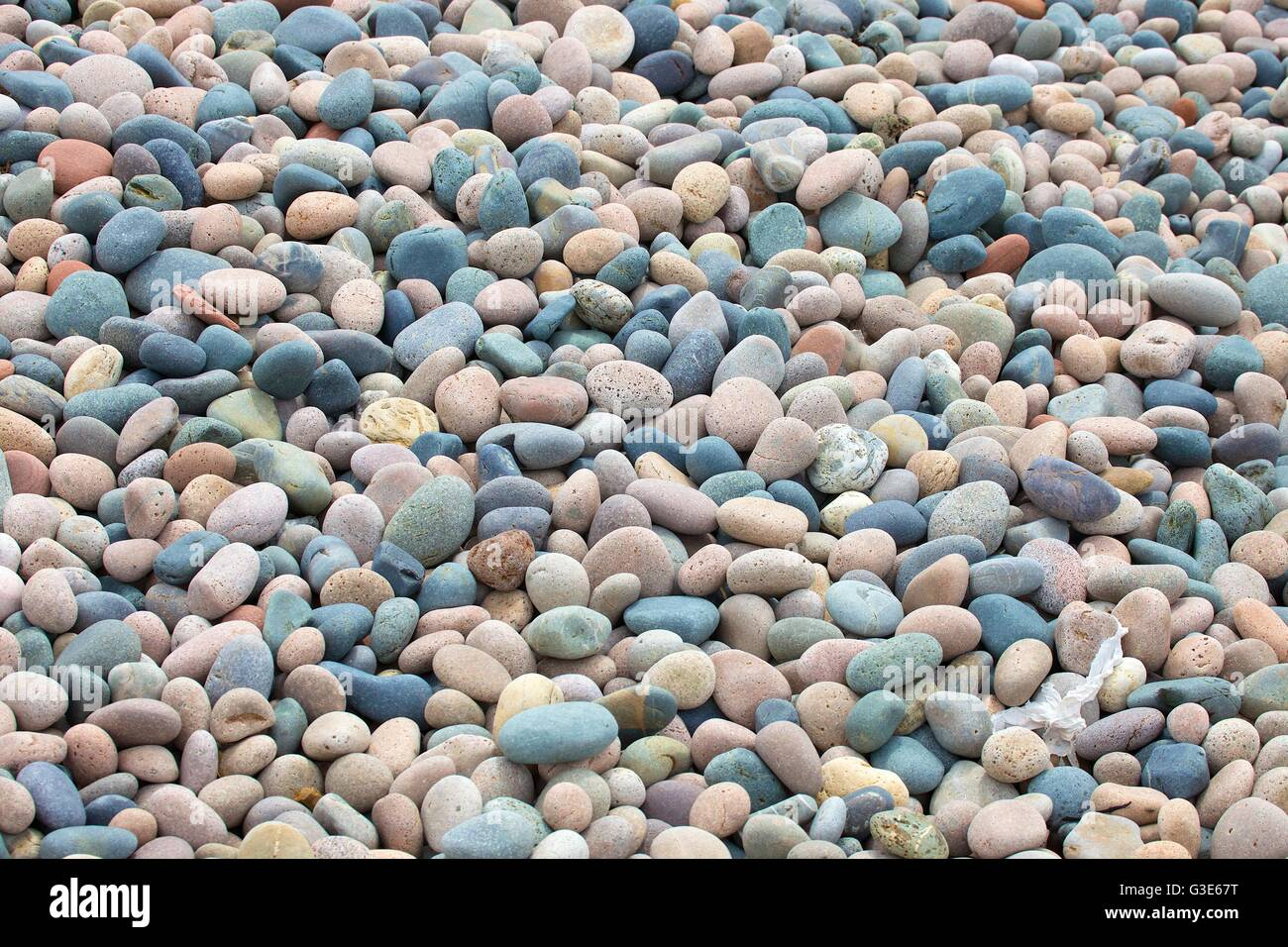 Pebbles. Close up of  shingle beach, stones background. - Stock Image