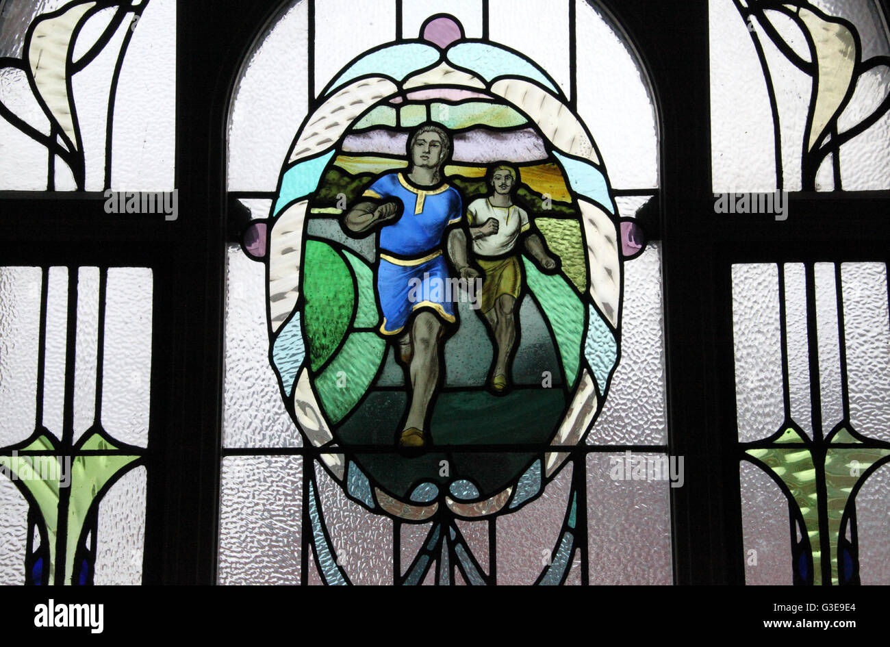 Sporting themed stained glass window at the restored Victoria Baths in Manchester - Stock Image