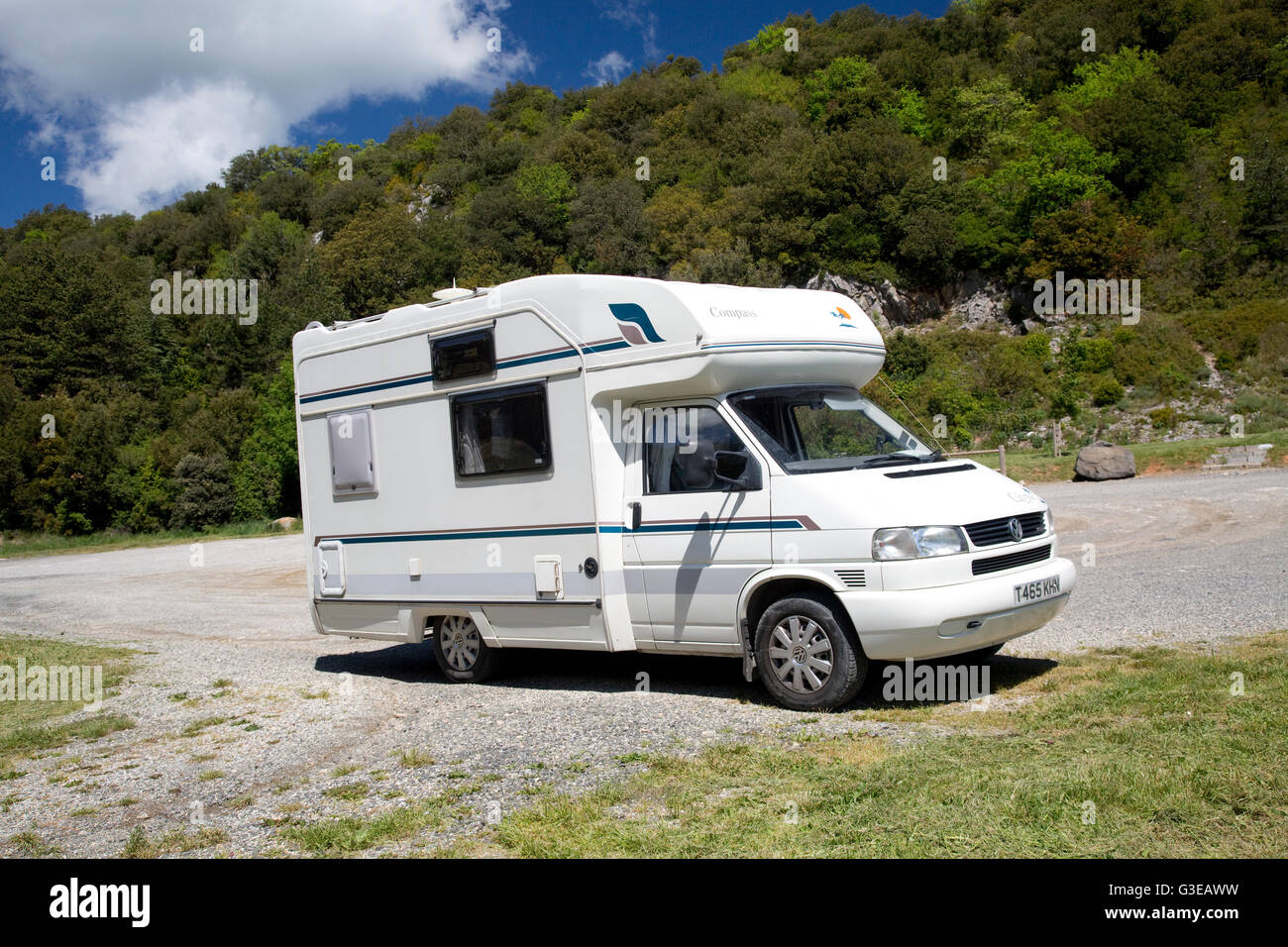 Compass Calypso campervan parked in forested rest area near Ginoles Pyrenees France - Stock Image