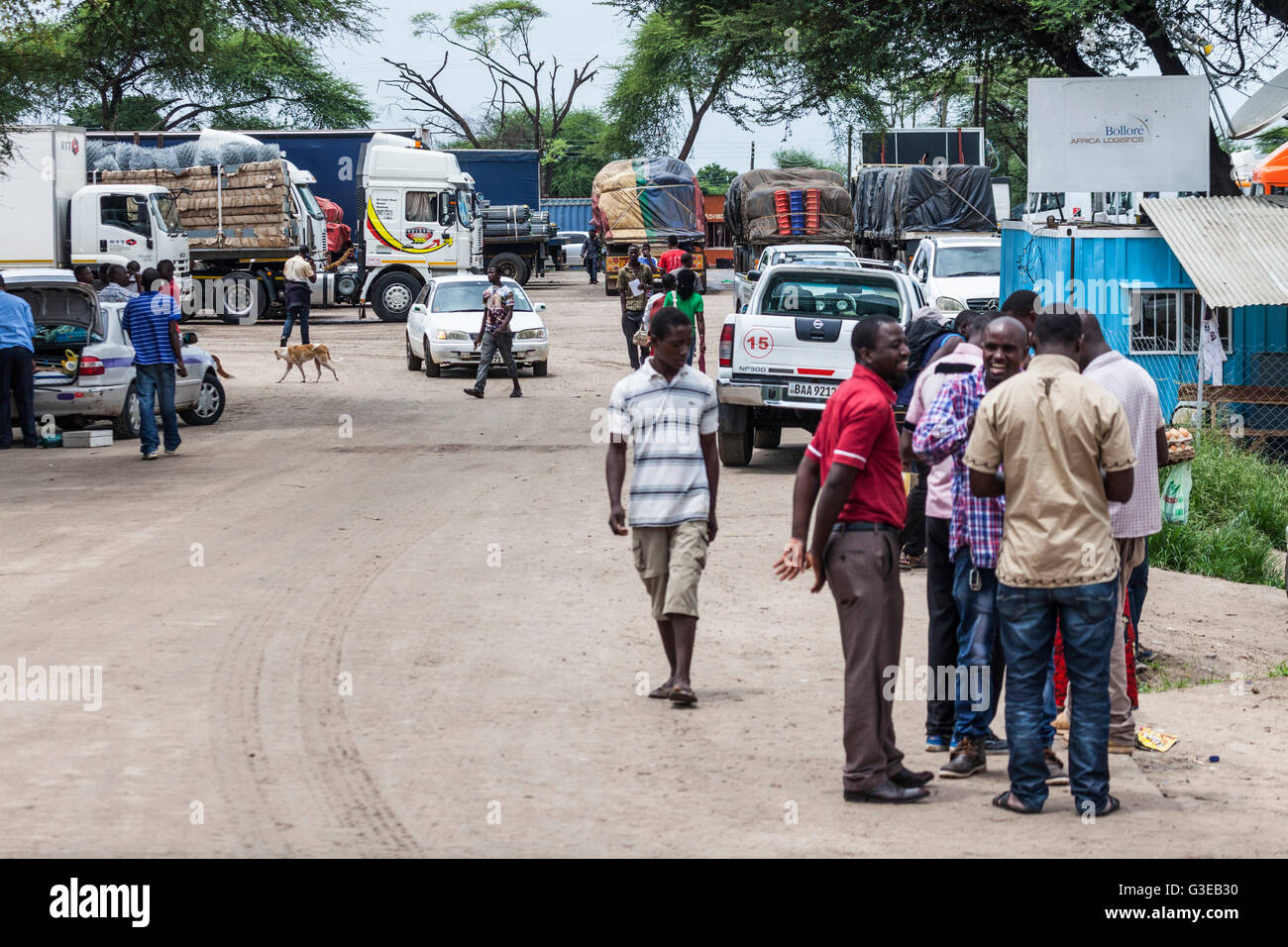 People and vehicles on the Zambian side of the Kazungula ferry to / from Botswana. - Stock Image