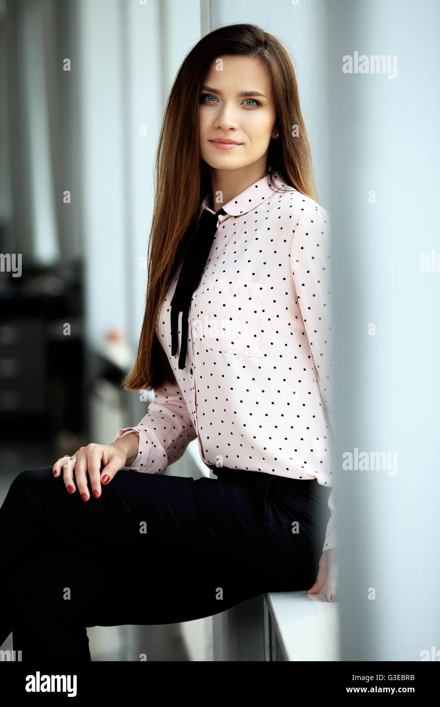 Modern business woman in office with copy space - Stock Image