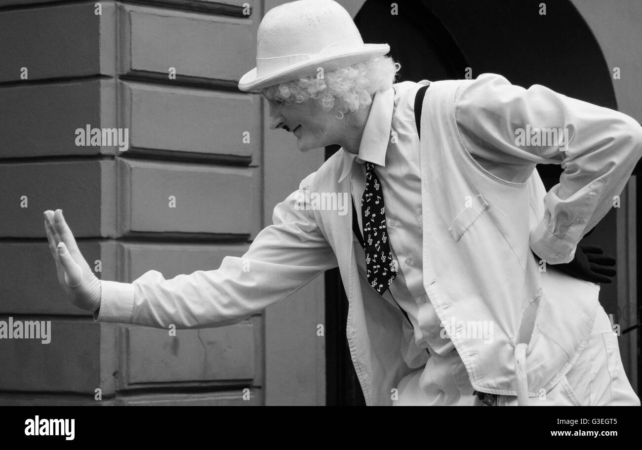 Street male mime entertaining tourists - Stock Image