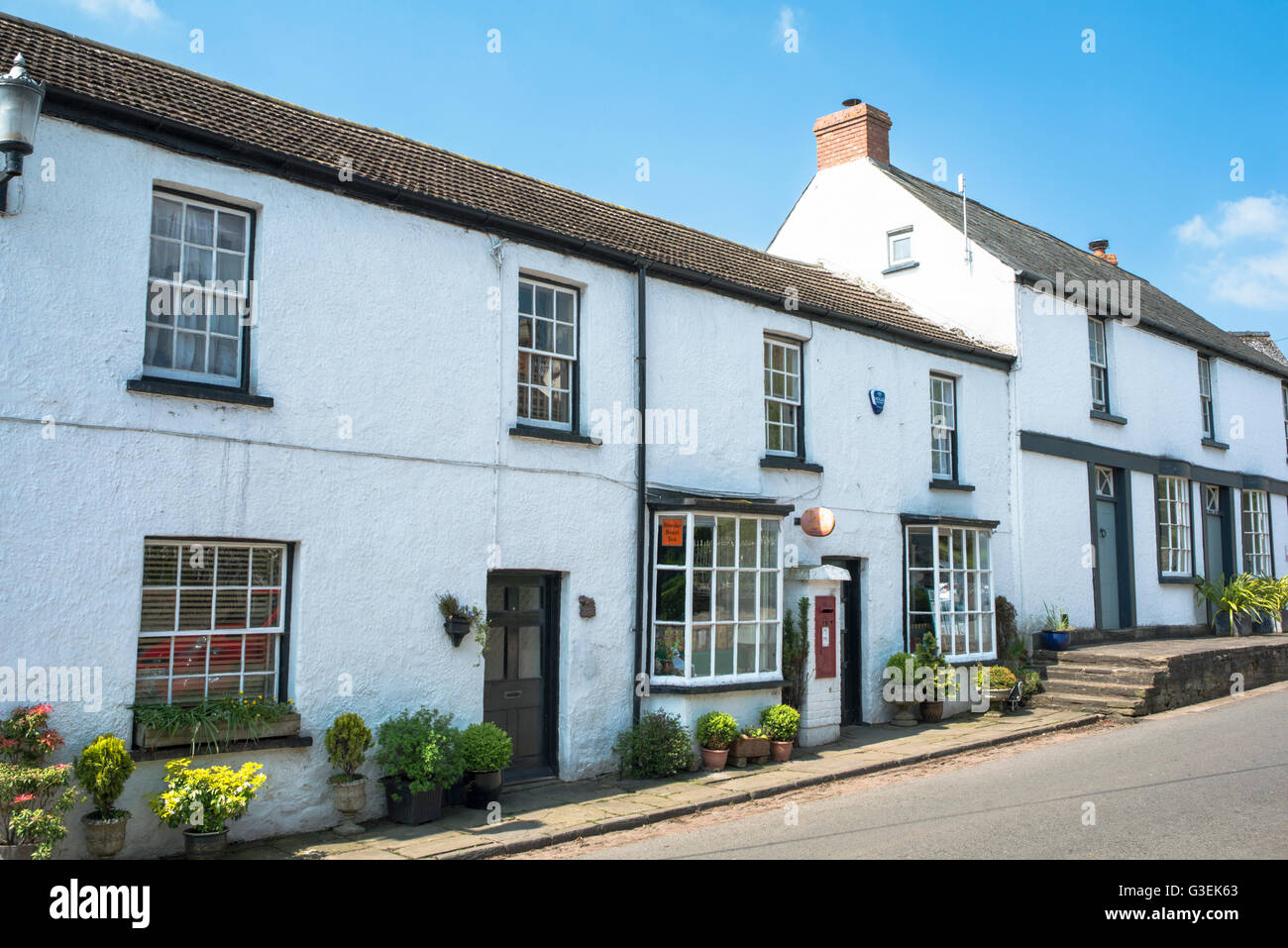 A village post office and local shop on a summer day. - Stock Image