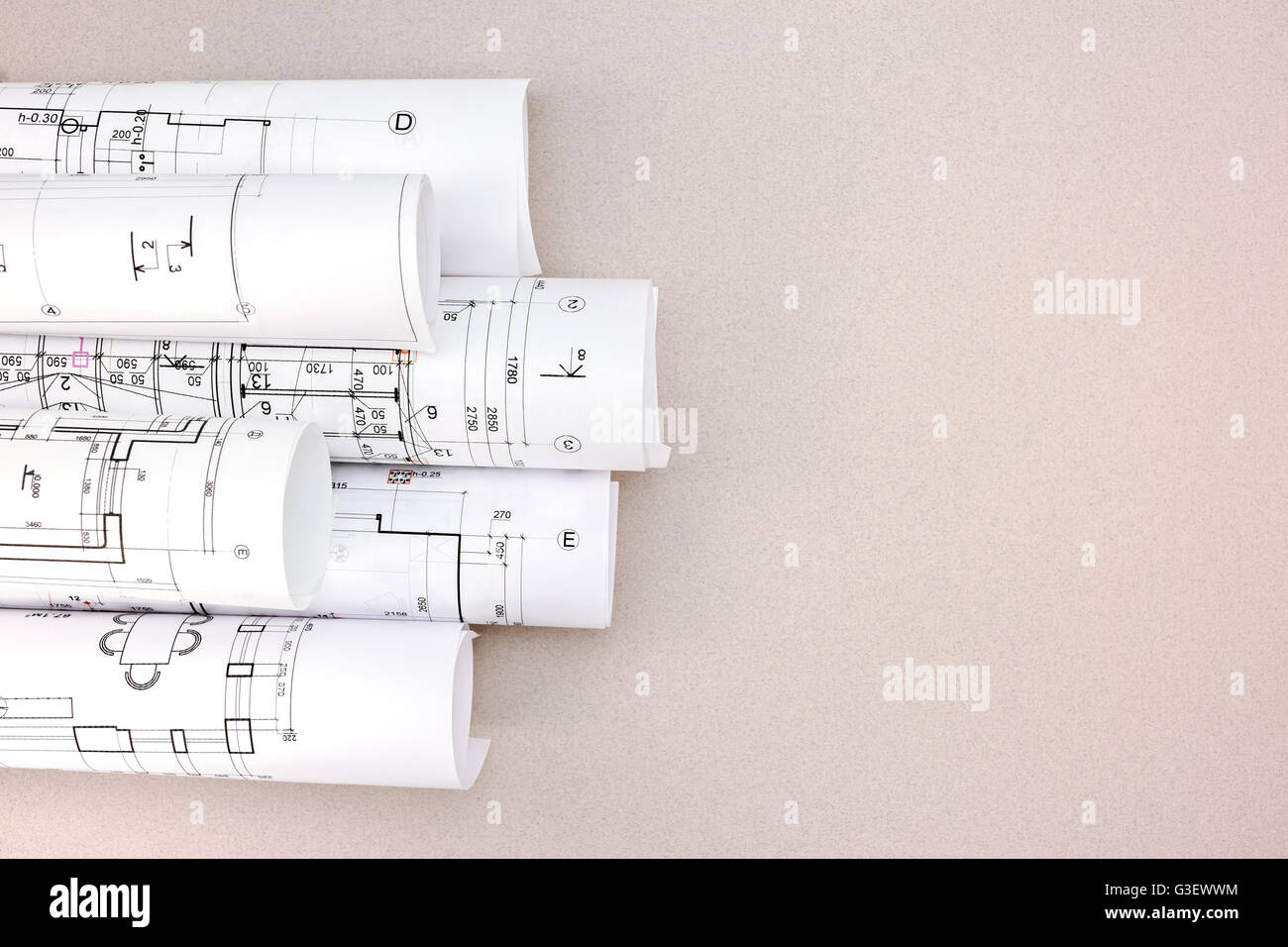 Rolls of architectural blueprints and house plans on the desk top rolls of architectural blueprints and house plans on the desk top view malvernweather Images