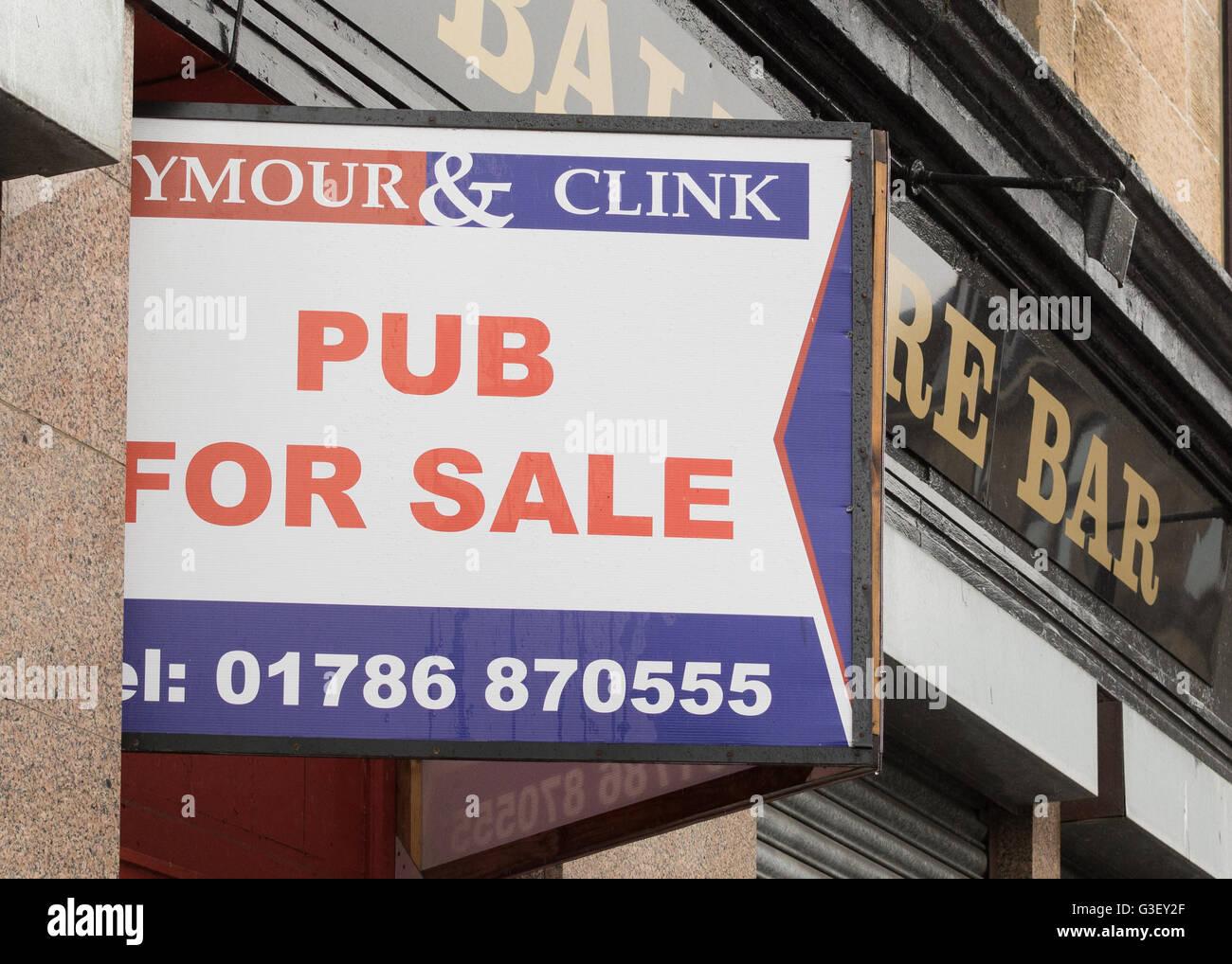Pub for Sale sign - outside the Balmore Bar, Possilpark, Glasgow, Scotland, UK - Stock Image
