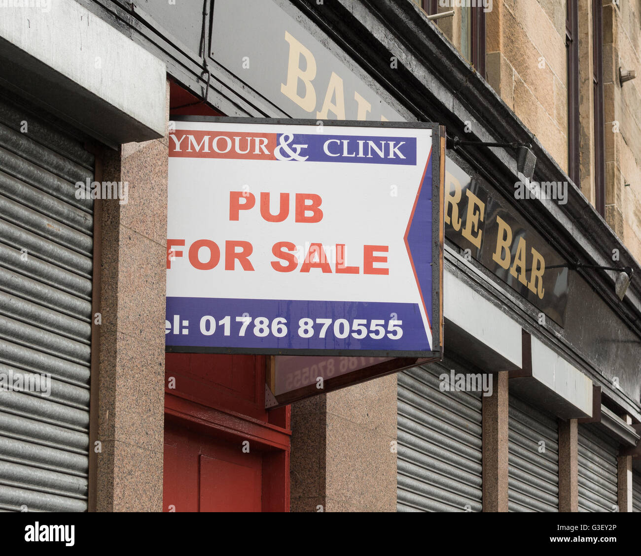 Pub for Sale sign outside the Balmore Bar, in Possilpark, Glasgow, Scotland, UK - Stock Image