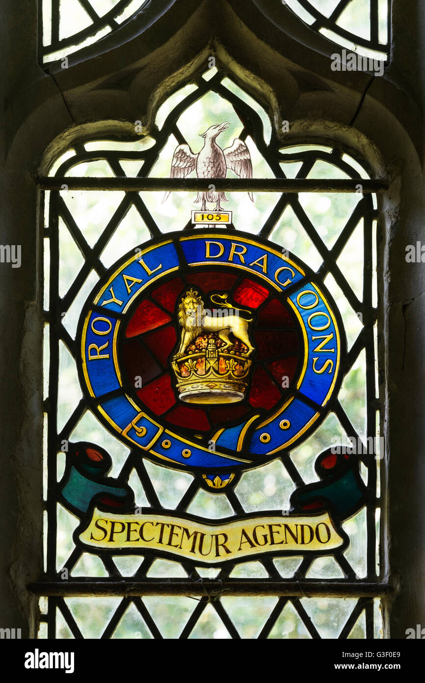 Royal Dragoons crest stained glass, St. Peter and St. Paul Church, Cosgrove, Northamptonshire, England, UK - Stock Image