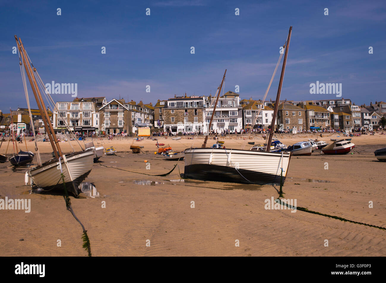 St Ives  harbour  in the county of Cornwall, England is a popular place to visit for tourists and is also a working - Stock Image