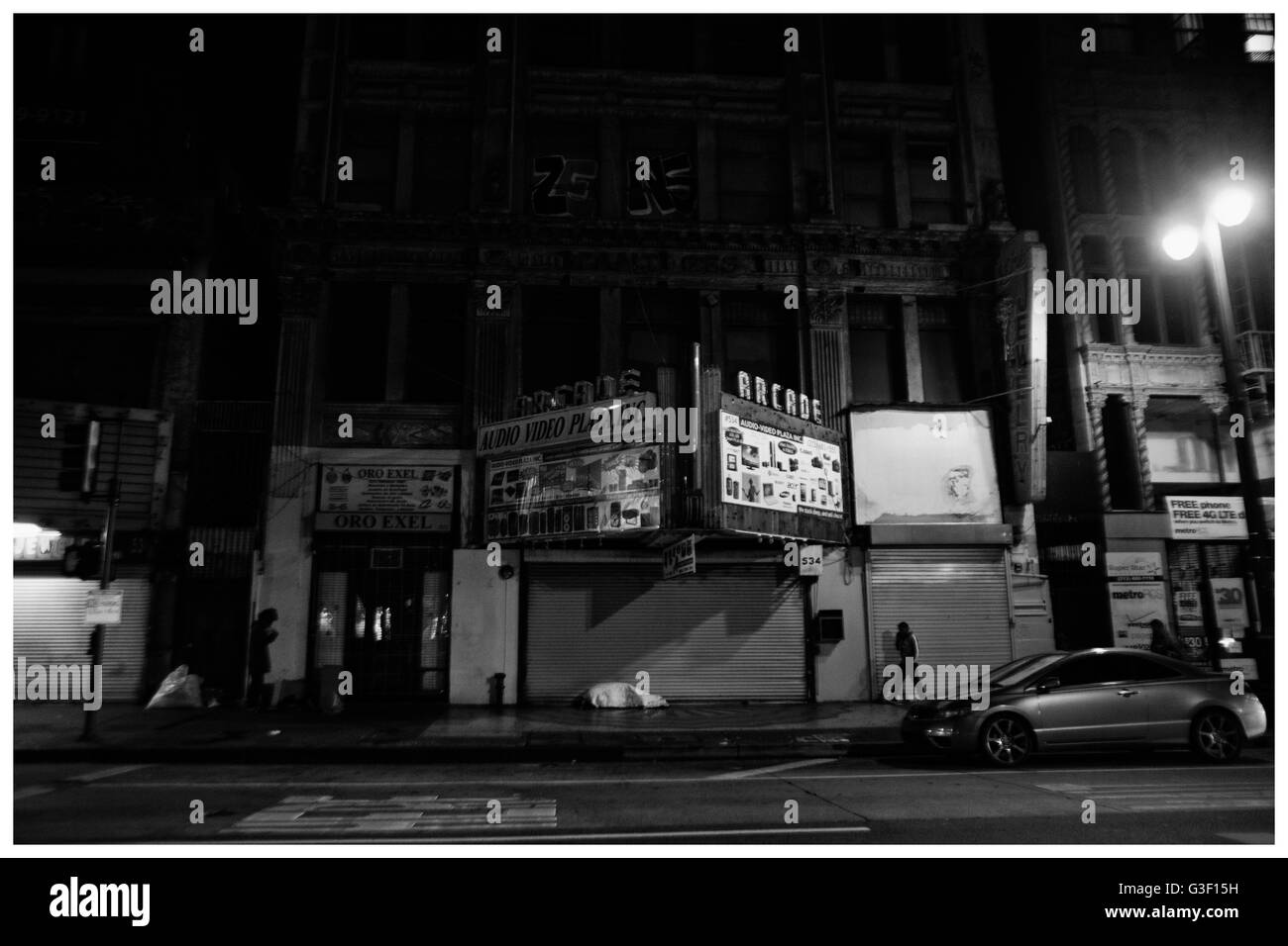LA Noir: Downtown Los Angeles at Night - Arcade Marquee on Broadway - Stock Image