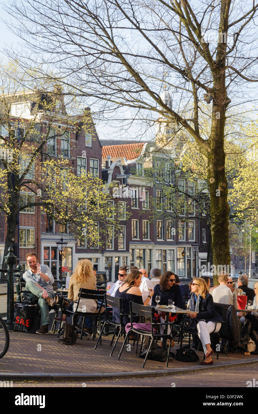 Prinsengracht corner Prinsenstraat, people in the street café, Amsterdam, Holland, Netherlands Stock Photo