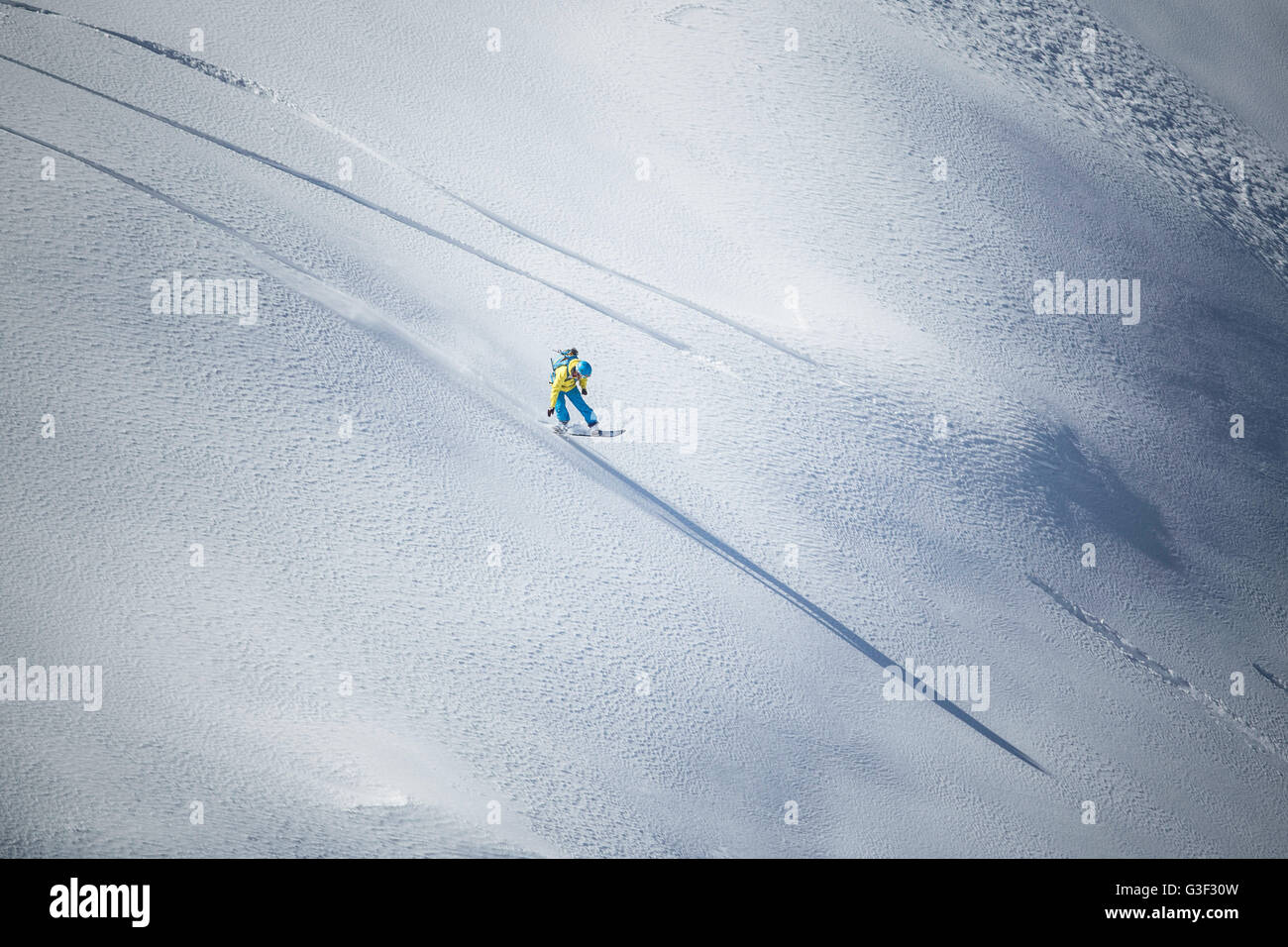 rapid downhill skiing with snowboard in the deep snow Stock Photo