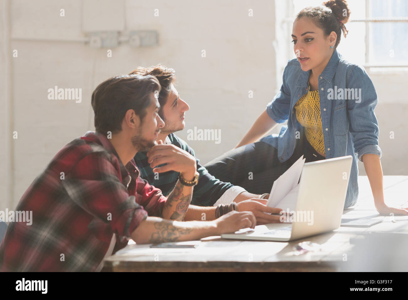 Creative young business people working in office - Stock Image