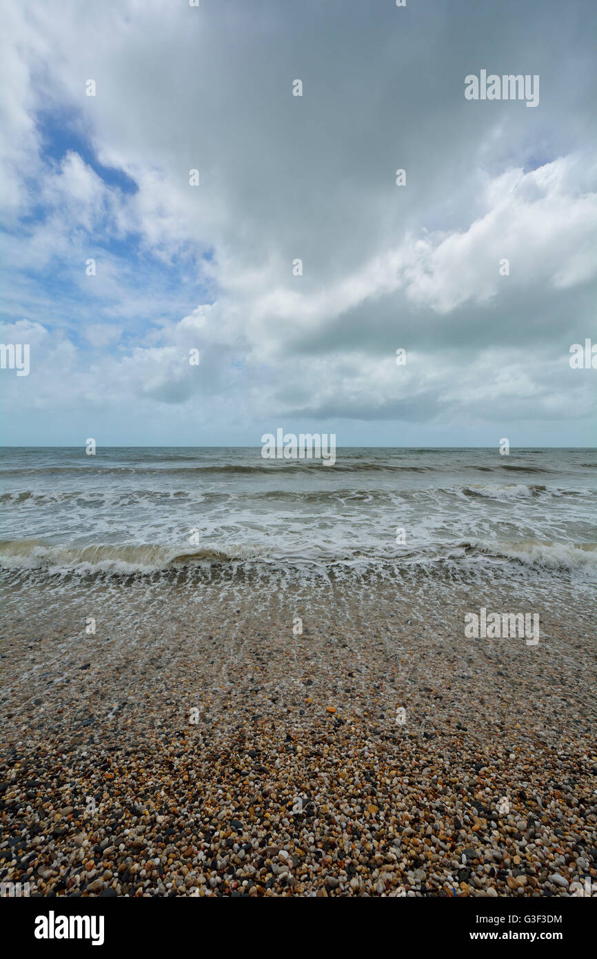 Pebble Beach with Rough Sea, Captain Cook Highway, Queensland, Australia - Stock Image