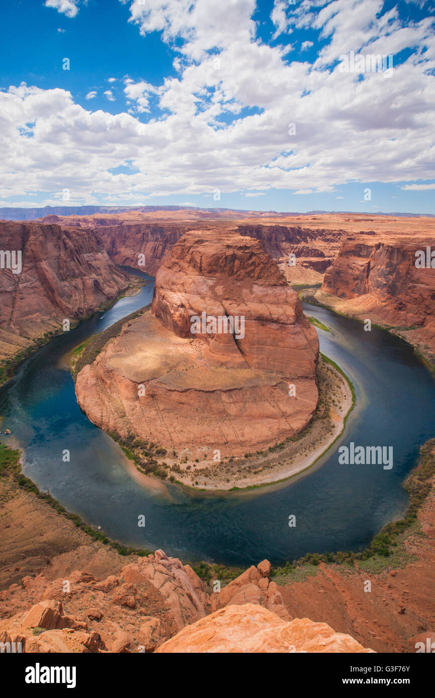 Cloudy blue sky covers the vast desert landscape of Arizona and the Colorado River. - Stock Image