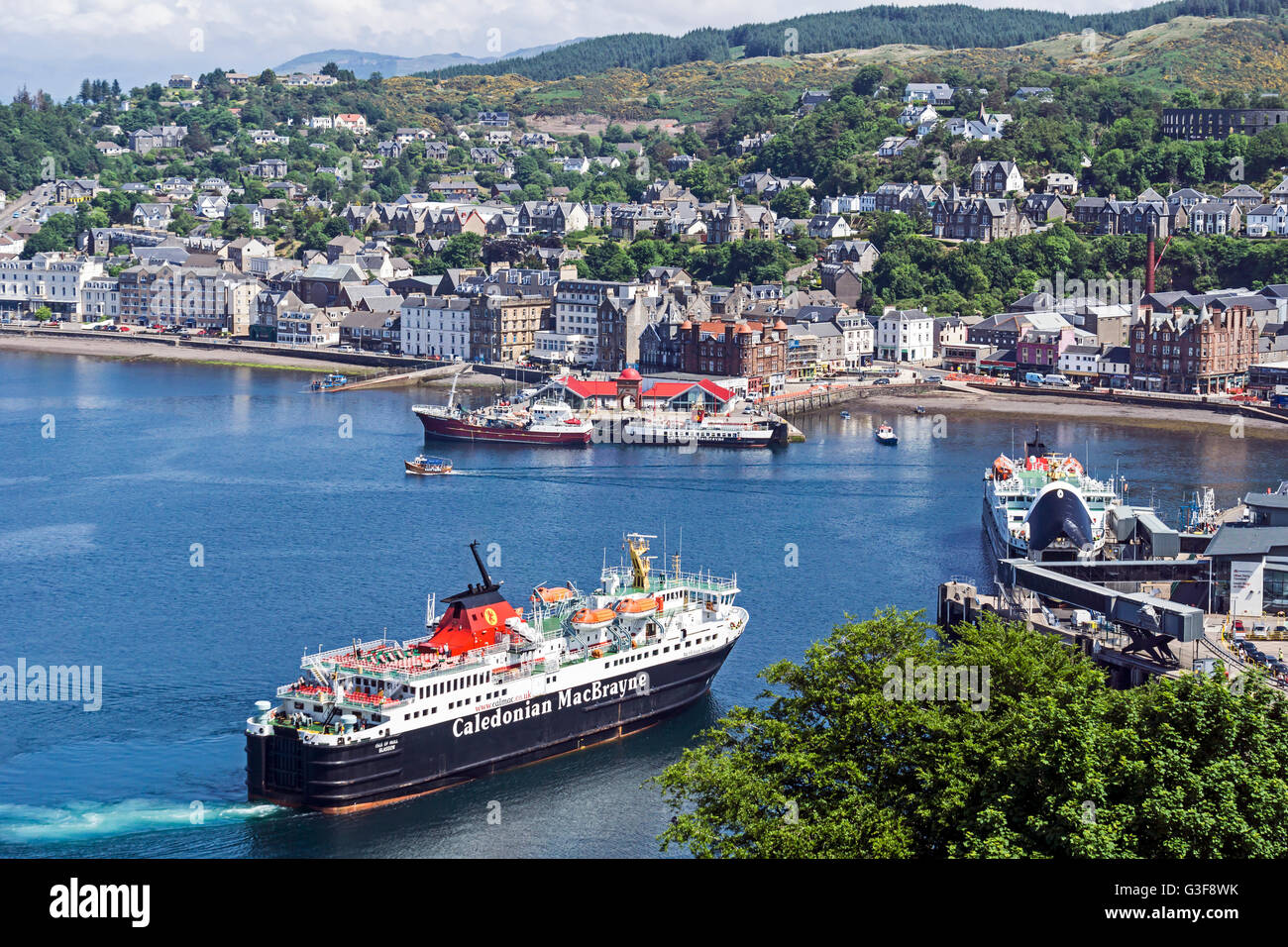 Caledonian Macbrayne car and passenger ferry Isle of Mull arriving at the berth in harbour Oban Argyll & Bute Scotland Stock Photo