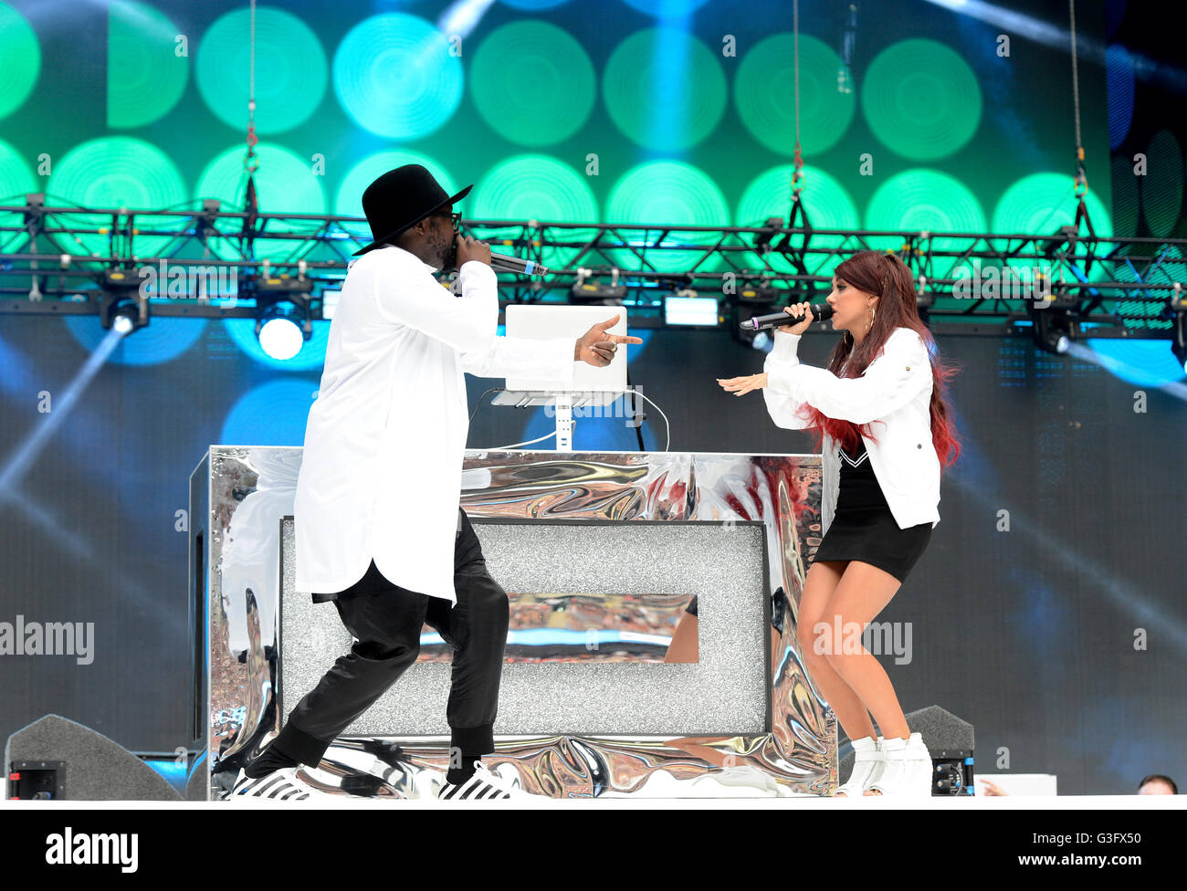 Will.I.am and Lydia Lucy performing at Capital FM's Summertime Ball with Vodafone held at Wembley Stadium, London. - Stock Image