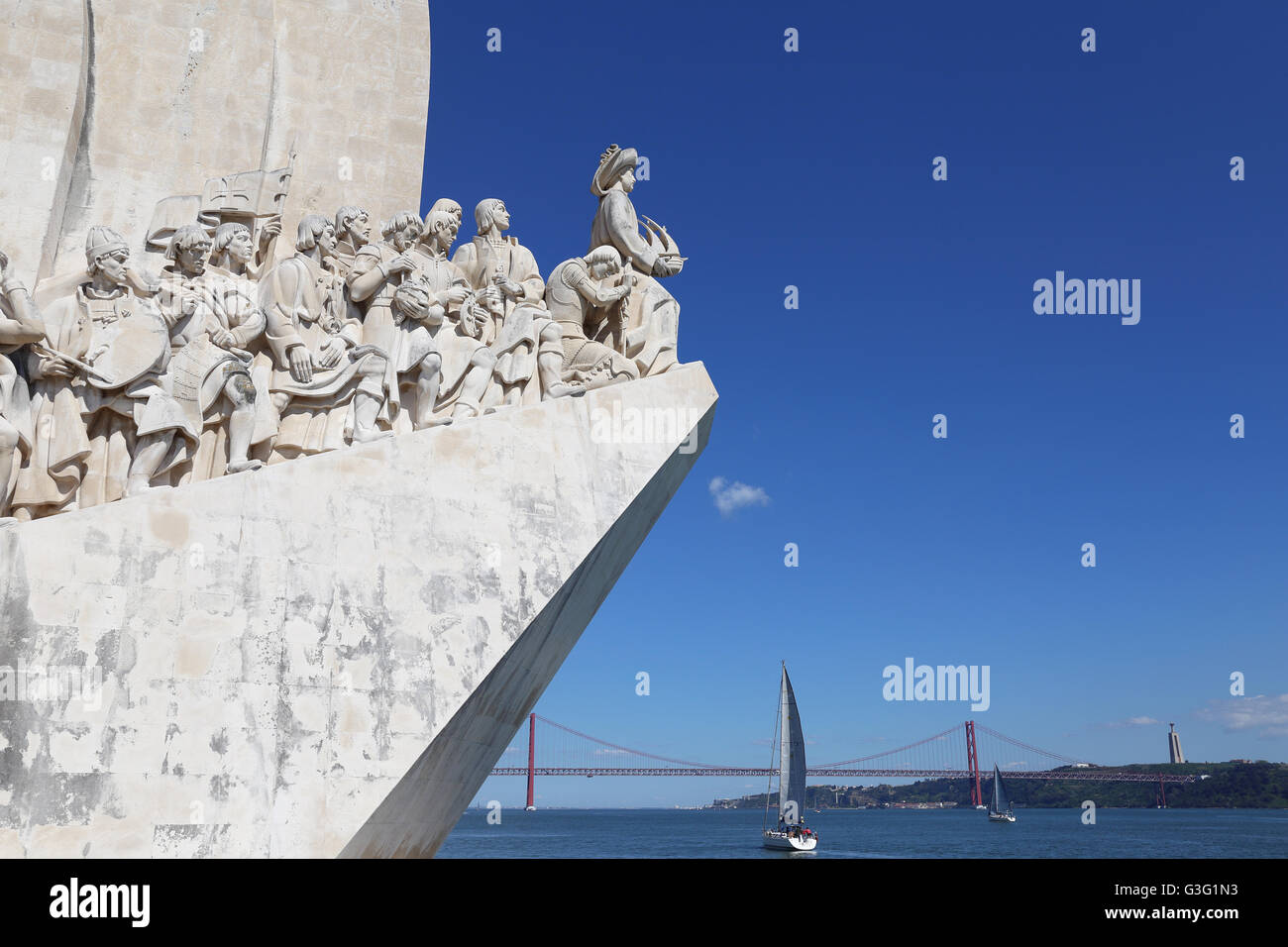 Discoveries Monument on the banks of the River Tagus at Belem, Lisbon, looking outwards past yachts and the April - Stock Image