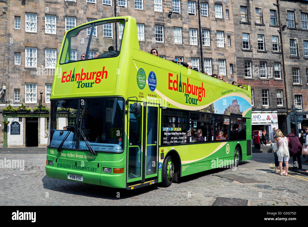 An Edinburgh Tour open topped bus in the Lawnmarket at the top of the Royal Mile in Edinburgh. - Stock Image