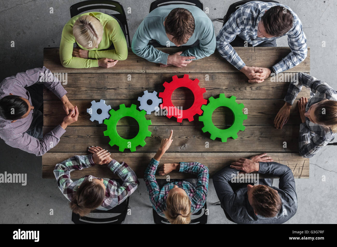 Hipster business team and cogs brainstorming planning meeting concept - Stock Image