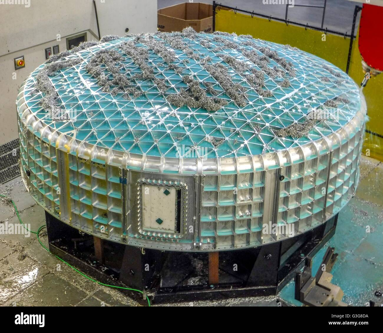 Aluminum burr waste is scattered over the first of four lower domes for the Boeing commercial crew CST-100 Starliner - Stock Image