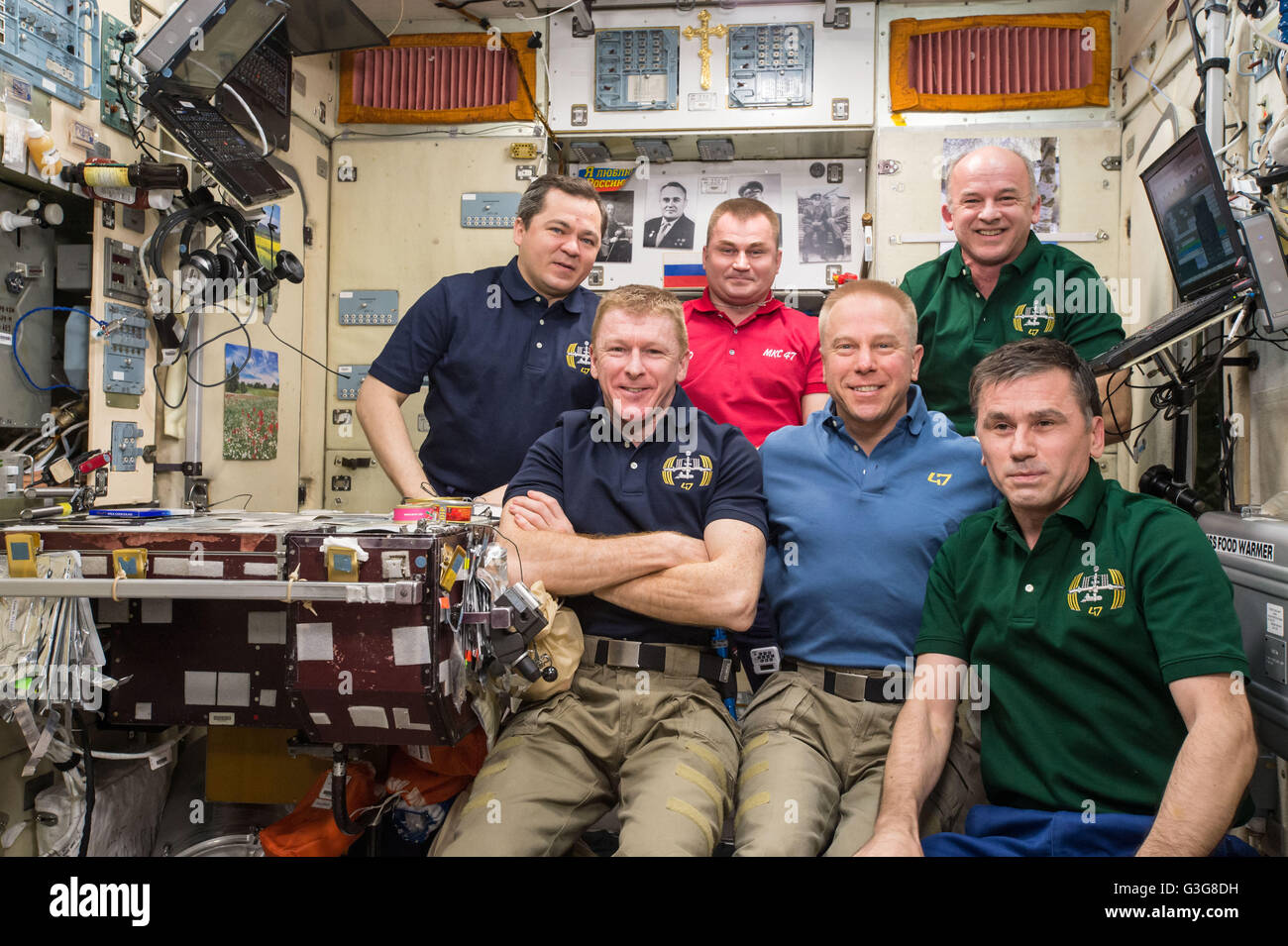 International Space Station Expedition 47 crew members pose for a group photo April 30, 2016 in Earth Orbit. Front - Stock Image