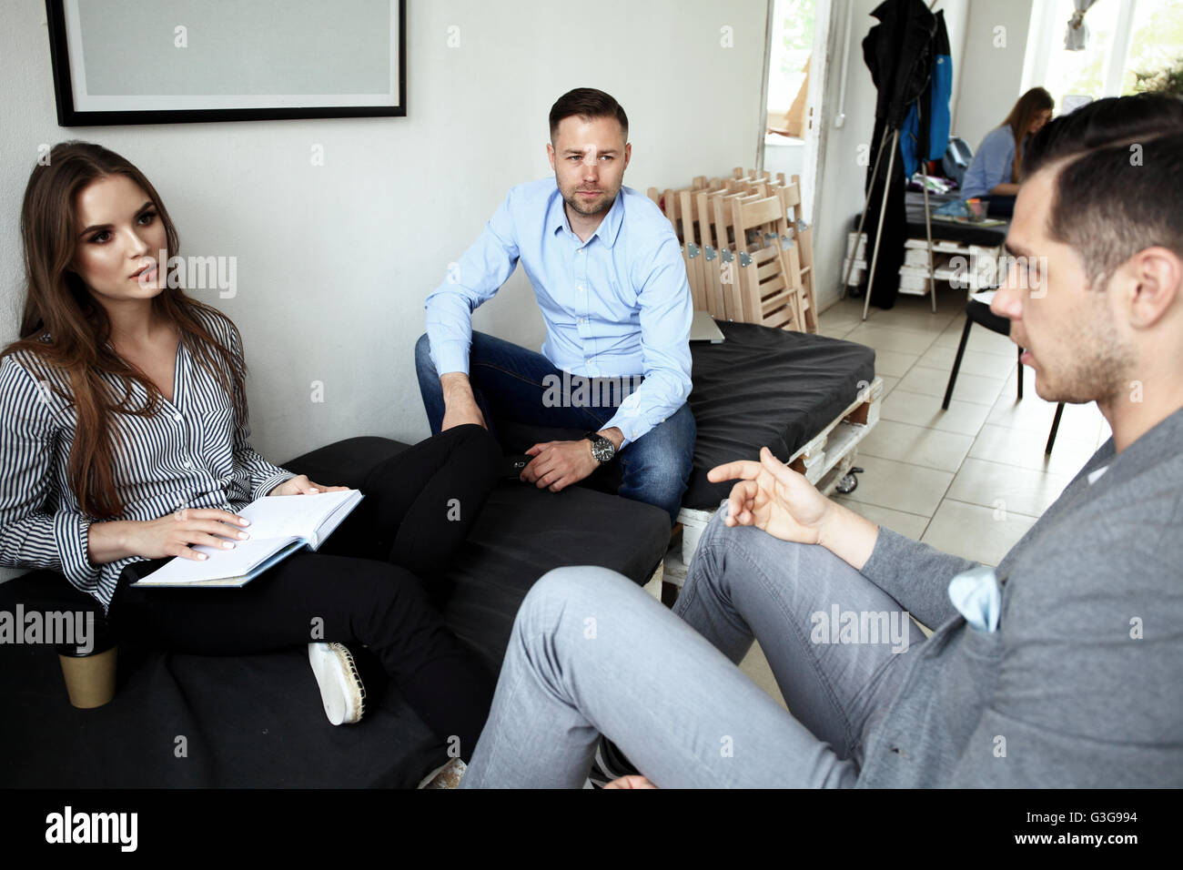 Creative business team working hard together in office - Stock Image